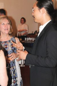 Joe Kwon Speaking with Guest of the Lomax Benefit Dinner