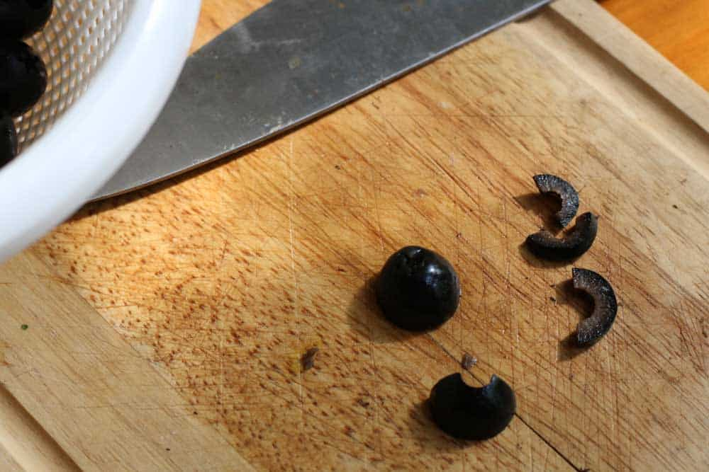 olives cut into pieces to make spider body for spider deviled eggs