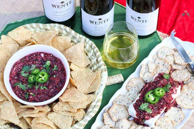 This Cranberry Salsa Recipe is easy, fresh, delicious, and can be made in 5 minutes! Dip it in chips or serve it over cream cheese with crackers. #ad #WenteVinyards