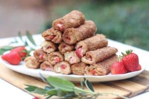 These Strawberry Stuffed Cinnamon Toast Roll-Ups have a crunchy, buttery, cinnamon and sugar crust and gooey strawberry cream cheese filling. They are great for entertaining because you can pick them up with your hands. Make these for your friends and family and they will feel extra special.