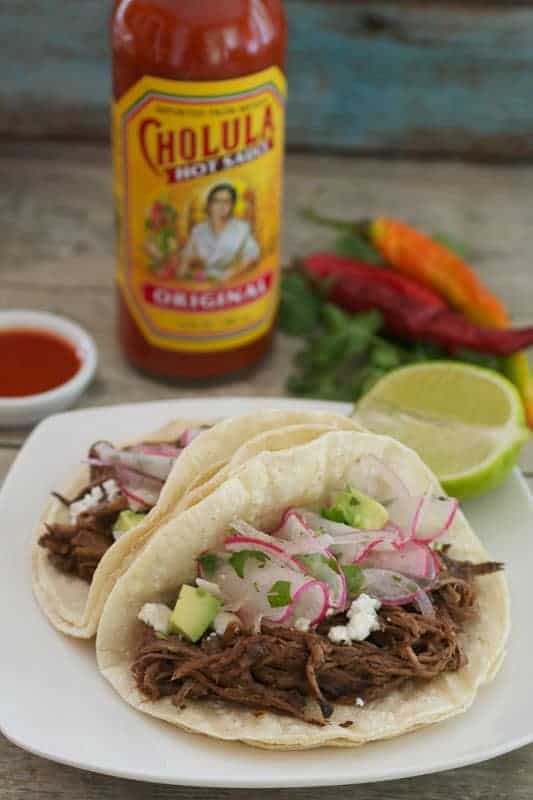 Get out the crock-pot for an easy and delicious recipe for Slow Cooker Cholula Shredded Beef Tacos. Perfect for #TacoTuesday!!
