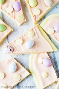 White Chocolate Easter Bark from Marsha's Baking Addition: A white chocolate layer topped with pink white chocolate, and studded with Cadbury Mini Eggs and white chocolate chips!