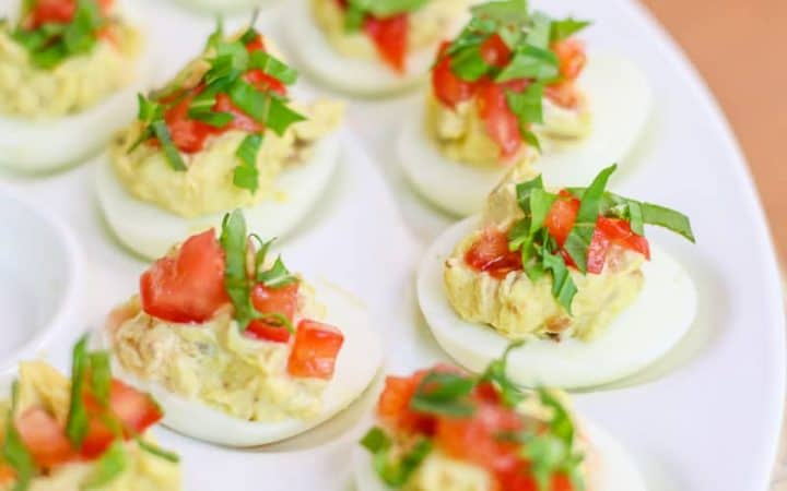 "This Easy BLT Deviled Eggs Recipe is wicked good. In fact, they will be the best deviled eggs you will ever make! They make a beautiful appetizer for a dinner and/or an ""eggscellent"" side dish for a cookout, barbecue, and family gathering. Watch out! These little deviled eggs disappear fast and people will beg for the recipe."