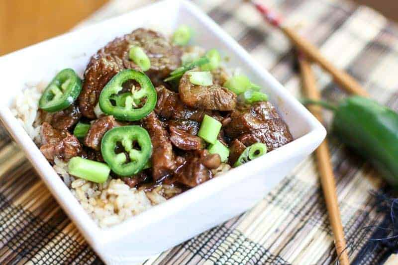 Jalapeño Mongolian Beef in a white square dish on a placemat