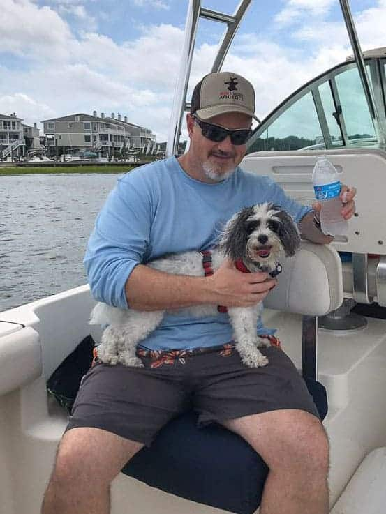 My husband holding my dog, Goliath.