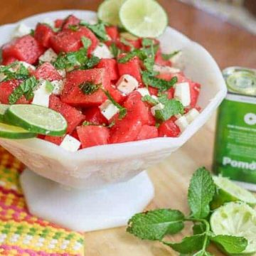 Brighten up your dinner table with this colorful lime infused Watermelon Mint and Feta Salad. This simple recipe is as tasty and delicious as it looks.