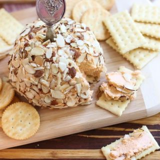 This swanky retro Port Wine Cheese Ball recipe was featured in City View Magazine. It has a sneaky heat balanced with the sweet port wine. Spread the cheese on crackers or apple slices for a fun party appetizer.