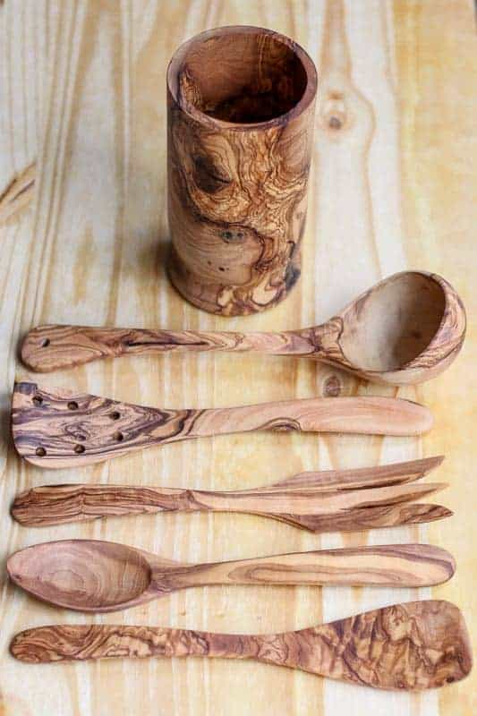 Wooden Spoons are a must have for any cook in the kitchen. This beautiful Handcrafted Olive Wood Utensil Set from Beldinest is the ultimate set. Made from old olive trees; this utensil set is naturally treated and then turned into a stunning piece of functional art. Any cook would love this wooden utensil set in their home.