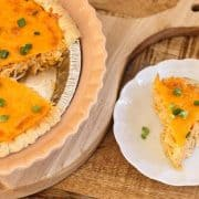Buffalo ranch chicken pie in a pie plate with a slice of pie on a plate to the side