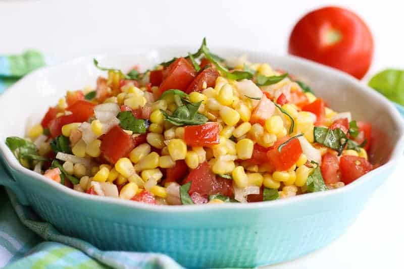 Corn salad in blue bowl.