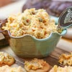 pimento cheese in pottery bowl on wood cutting board