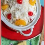"Ambrosia Salad is an American variation of fruit salad that has been around for years. This classic ""church salad"" has been made for many church family gatherings, potlucks, backyard barbecues, and pig pickings.  It is quick and easy to make. Make Ambrosia Fruit Salad for your next gathering!"
