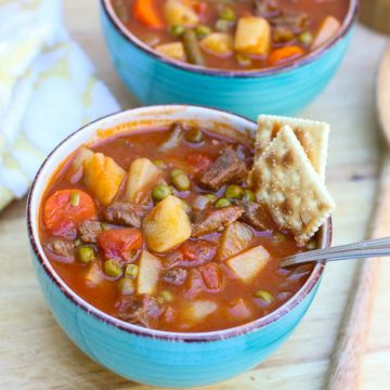 Crockpot Vegetable Beef Soup is made with tender chunks of beef and hearty vegetables that are slow cooked in a flavorful tomato broth.