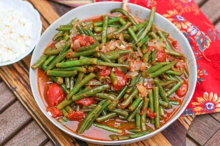 Greek Green beans in a large grey bowl with red napkin to the side