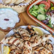 This yogurt based Greek chicken marinade makes chicken tender and moist. The Mediterranean seasonings of lemon, garlic, oregano, and parsley makes the chicken flavorful. You can use it on baked or grilled chicken. It is also perfect for making chicken kebabs. #aforkstale #Greekchicken #Greekchickenmarinade