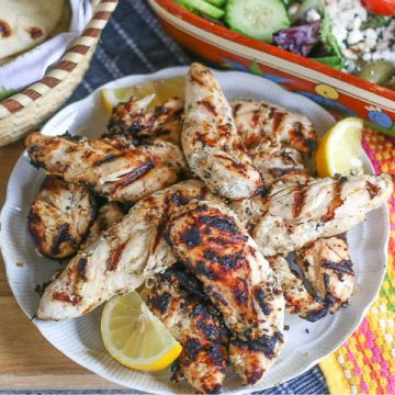 plated Greek marinated grilled chicken on a white plate