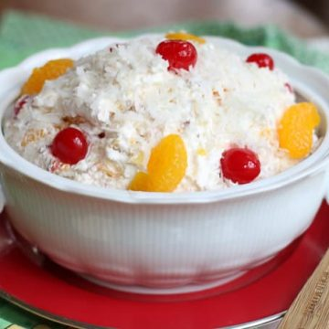 Fruit salad with cherries, mandarin oranges, coconut, and cool whip