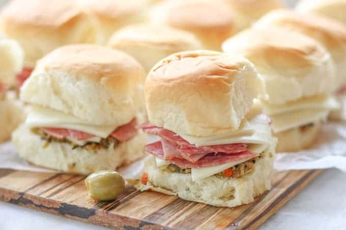 Muffaletta Sliders on a wooden tray