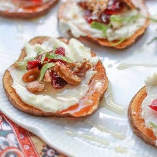 Sweet potato bites with goat cheese on a plate