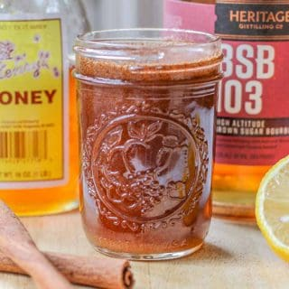 homemade cough syrup with honey, cinnamon, lemon, and bourbon