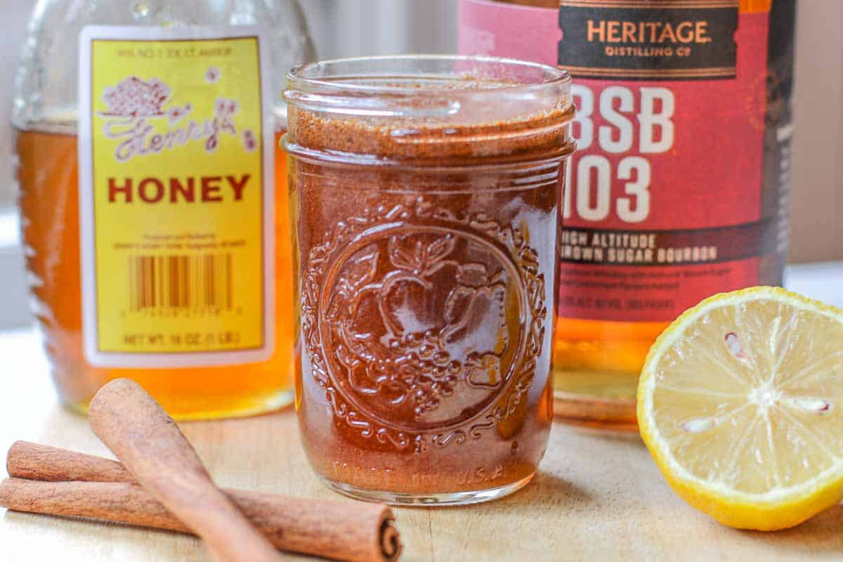 homemade cough syrup with honey, cinnamon, lemon, and bourbon
