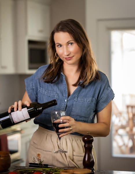 Katie Crenshaw pouring wine