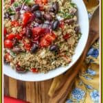 Mediterranean Quinoa Salad is mixed with olives, feta cheese, Kalamata olives, tomatoes, cucumbers, and a vibrant flavored lemon dressing. It is perfect as a delicious side dish or as a healthy entree by itself.