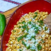 This bright and zesty Mexican corn salad is basically deconstructed Mexican street #corn off the cob. It combines a flavorful combination of corn, cotija cheese, and a lime/mayonnaise dressing. You can serve it hot or cold. #aforkstale #streetcorn