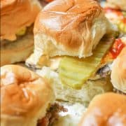 This juicy oven baked burger sliders recipe was inspired by the famous Krystal and White Castle Burgers. These flavorful little cheeseburgers are easy to make in big batches and are guaranteed to disappear in minutes! #ovenburgers #cheeseburgersliders
