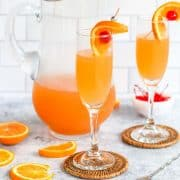buck's fizz chamapagne punch on a white counter