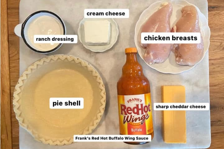 ingredients for Buffalo Ranch Chicken Pie-ranch dressing, cream cheese, chicken breasts, buffalo wing sauce, pie crust, cheddar cheese