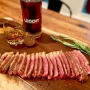 sliced Wagyu steak on wood cutting board