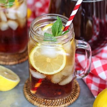 iced sweet tea with a straw coming out of it