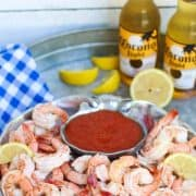 Follow these easy tips and steps on how to boil #shrimp to make the perfect #shrimpcocktail. Also included are detailed instructions on how to peel and devein shrimp. #aforkstale