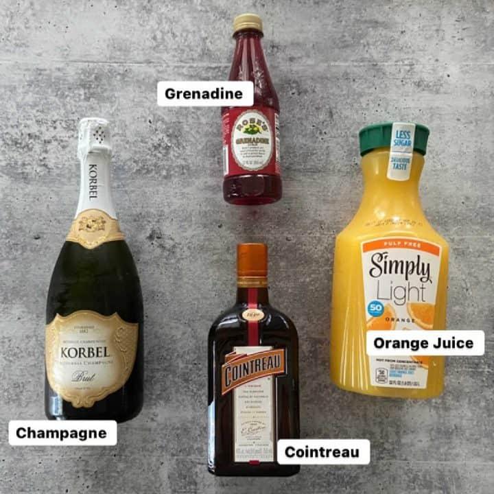 Ingredients for Buck's Fizz champagne punch-champagne, grenadine, orange juice, Cointreau