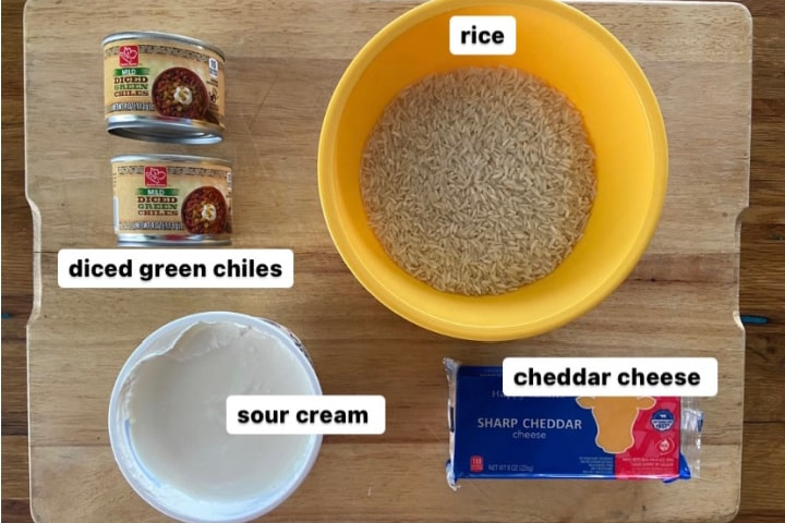 ingredients for green chile rice casserole: canned green chiles, rice, sour cream, cheddar cheese
