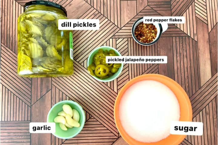 ingredients to make fire and ice pickles: dill pickles, sugar, garlic, red pepper flakes, and pickled jalapeno