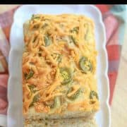 This Easy Cheesy Jalapeño Cheddar Beer Bread Recipe makes some of the best homemade bread that can be made in the kitchen. With a moist center, a crunchy cheesy outer crust, and a salty, slightly sweet and spicy flavor; this bread is delicious by the slice or used for a gourmet sandwich! #beerbread #bread
