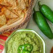 Jalapeno salsa is a flavorful spicy creamy salsa. Its creamy texture is created from roasted jalapenos, onions, and garlic that is combined with fresh cilantro, lime juice, and olive oil. This Mexican green sauce is great on chips or your favorite tacos! #salsa #jalapeno