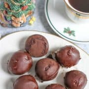 Peanut Butter Bon Bons, (also known as Buckeyes) are made with a creamy peanut butter filling then covered in chocolate. They are an easy, no bake dessert. They are perfect to add to your homemade Christmas candies. They also make a wonderful homemade food gift!