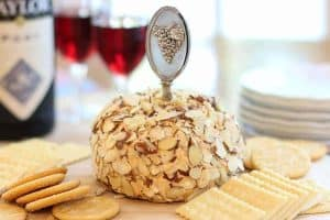 port wine cheese ball and crackers on wood board