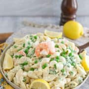 This shrimp pasta salad is a cold, creamy, mayonnaise-based pasta salad combined with fresh shrimp, sweet garden peas, boiled eggs, and onion. #shrimppastasalad #coldpastasalad #mayobasedpastasalad