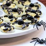 deviled eggs with black olives shaped like spiders