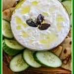 Tzatziki sauce is a delicious creamy yogurt-based sauce made with grated cucumbers, olive oil, white vinegar, and seasonings. Follow these easy steps to make it homemade. #tzatziki #cucumbersauce